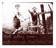Well pulling crew with Hard Boiled hard hats